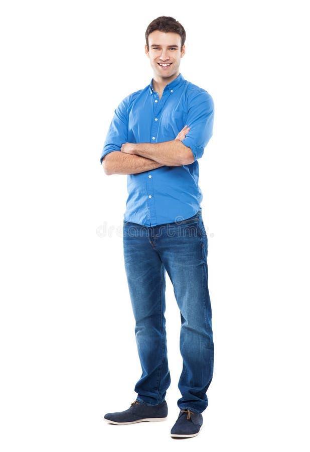 站立反对白色背景的年轻人 免版税库存照片