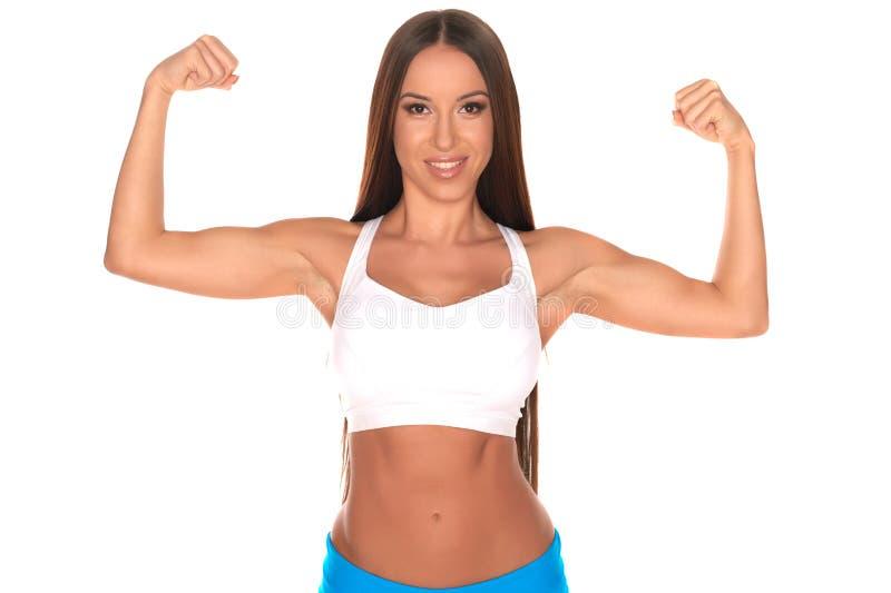 站立反对被隔绝的白色背景的健身妇女 免版税库存图片