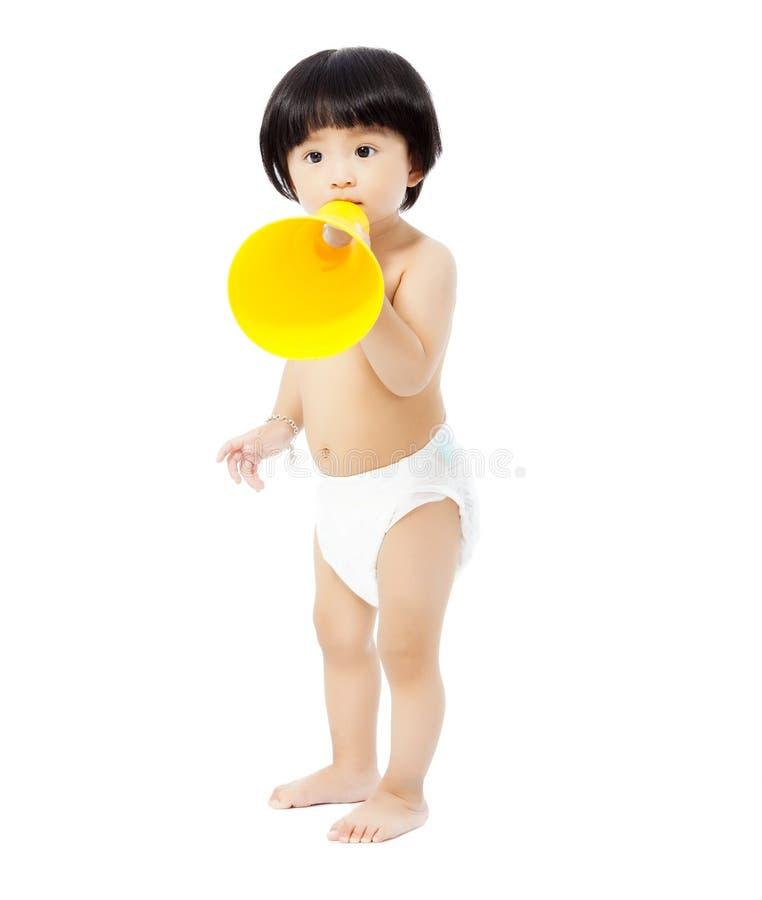 站立和拿着扩音机的逗人喜爱的女婴 库存图片