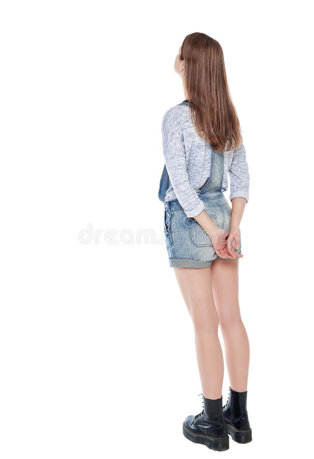站立和看在某事的十几岁的女孩 后面姿势,充分 免版税库存照片