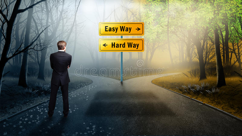 站立在交叉路的商人有选择容易的方法和坚硬方式 库存图片