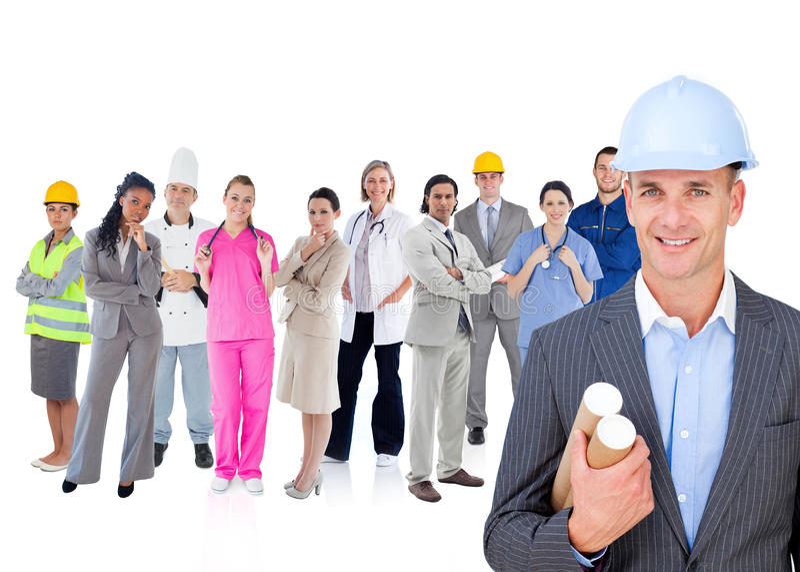站立在工作者前面的不同的类型的建筑师 图库摄影