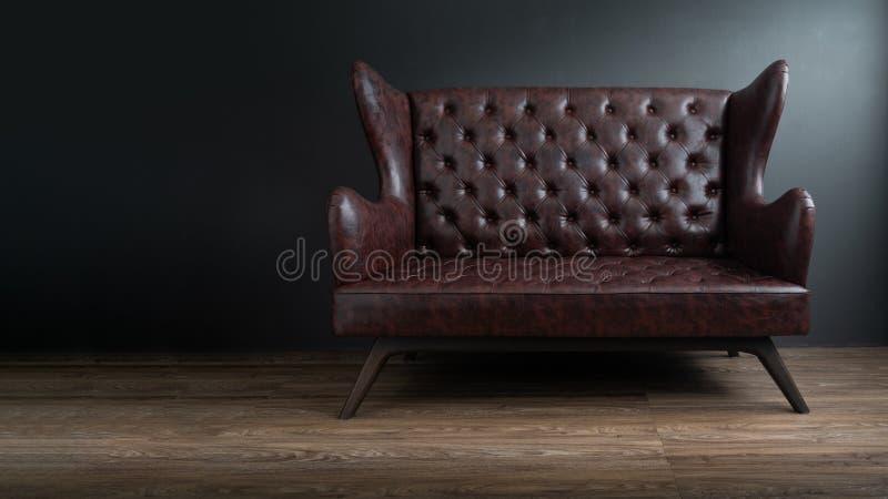 站立在水泥地板上的中心的黑皮革沙发对有拷贝空间的深灰墙壁 葡萄酒棕色皮革沙发与 图库摄影