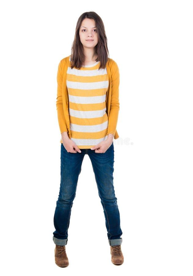 站立在牛仔裤和T恤杉的少妇 免版税图库摄影