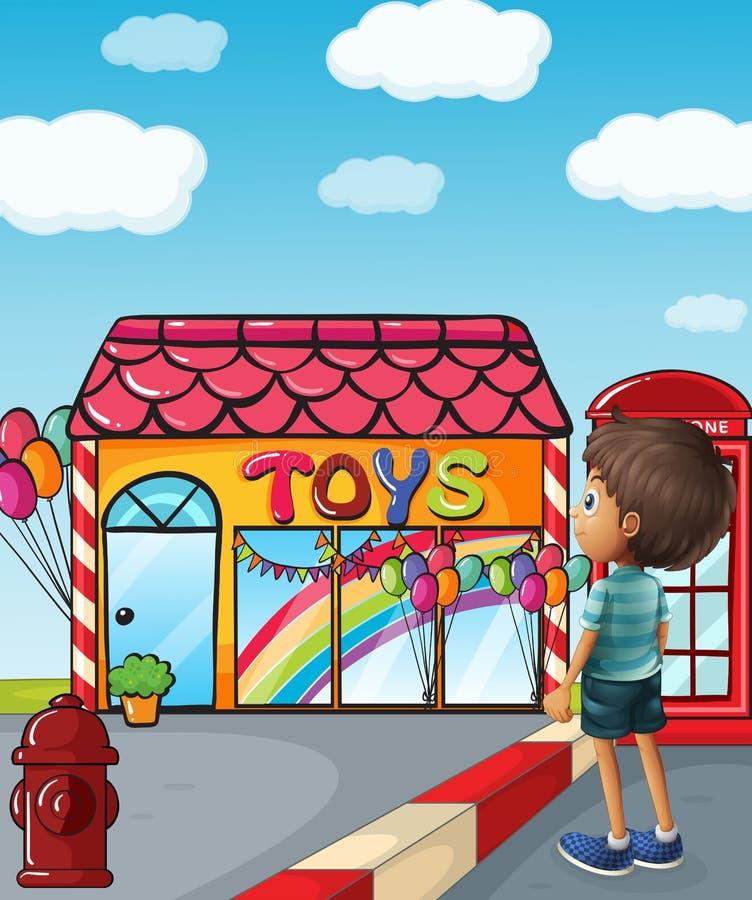 站立在玩具店附近的男孩 皇族释放例证
