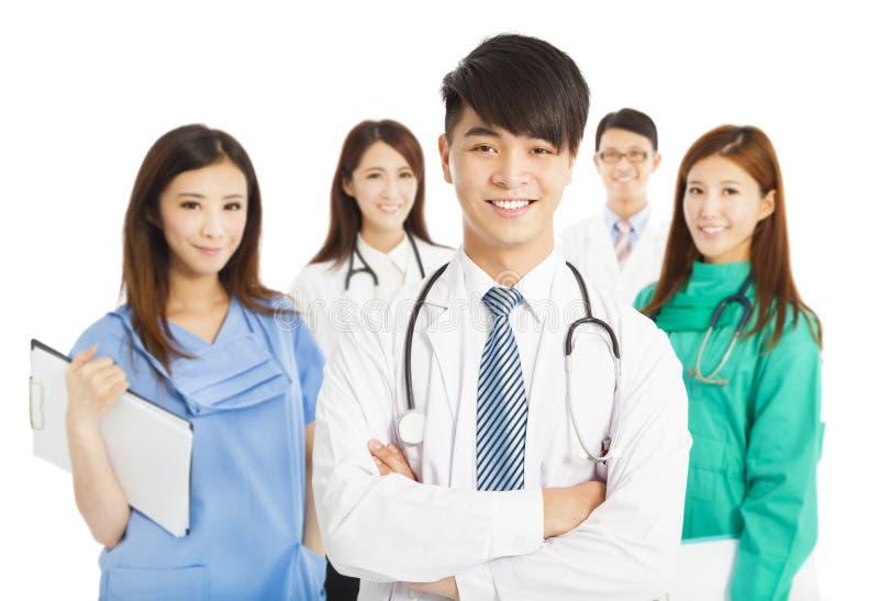 站立在白色背景的专业医生队 库存图片