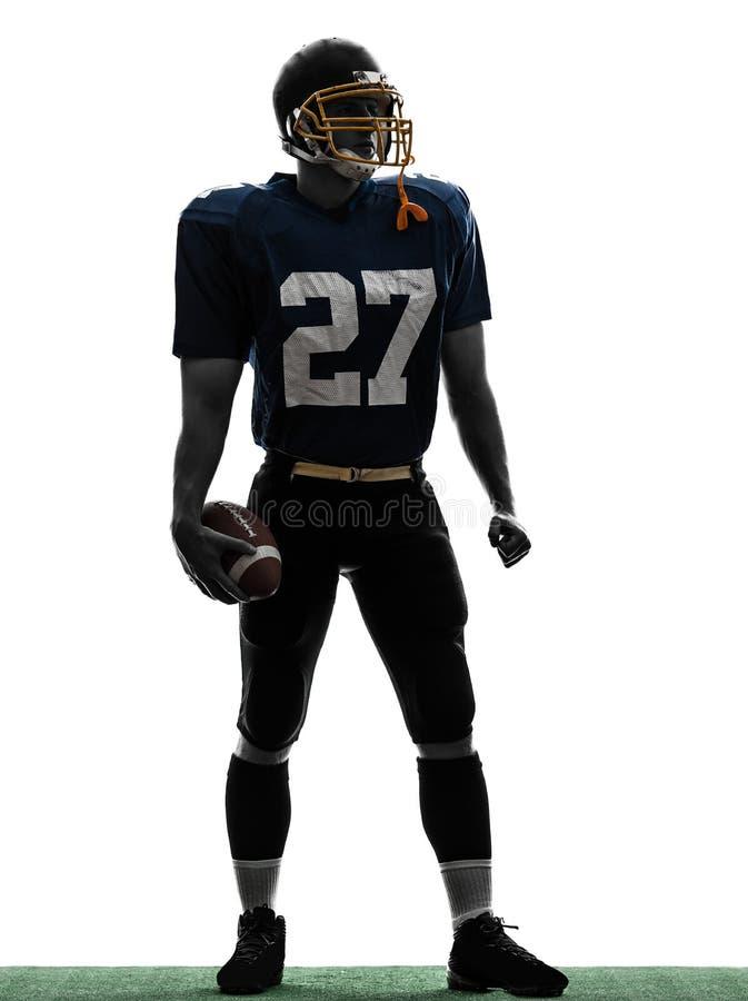 四分卫美国橄榄球运动员人常设剪影 免版税库存图片
