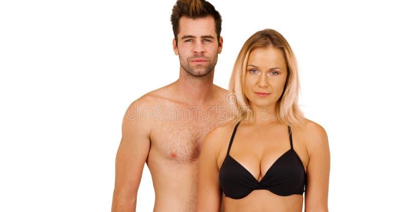 站立在白色背景的性感的白色千福年的夫妇画象  库存图片