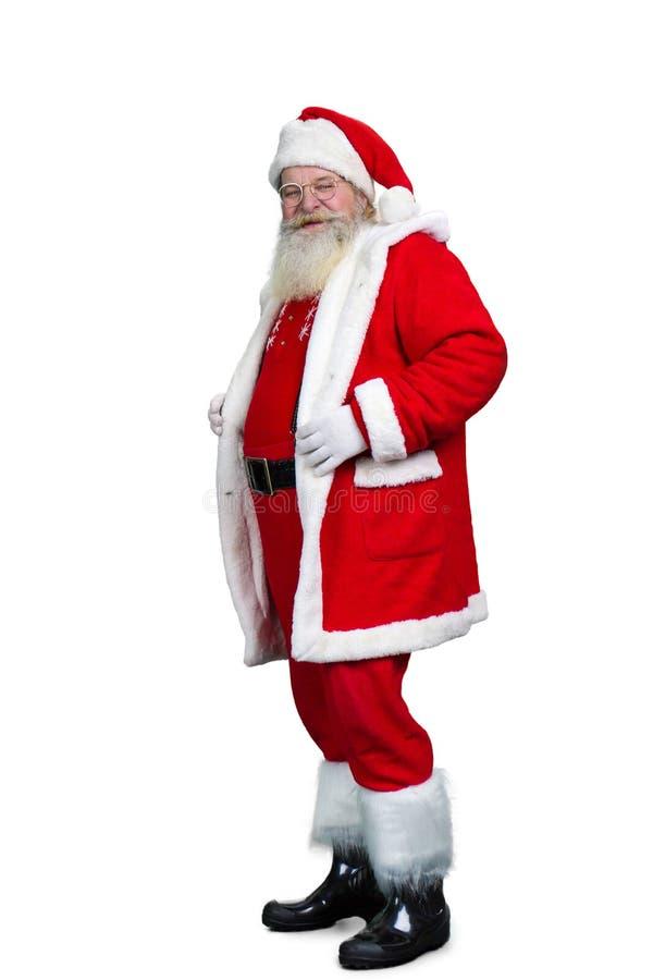 站立在白色背景的资深圣诞老人 免版税图库摄影