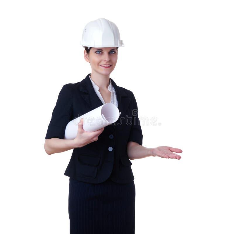 站立在白色被隔绝的背景的微笑的女实业家 免版税图库摄影