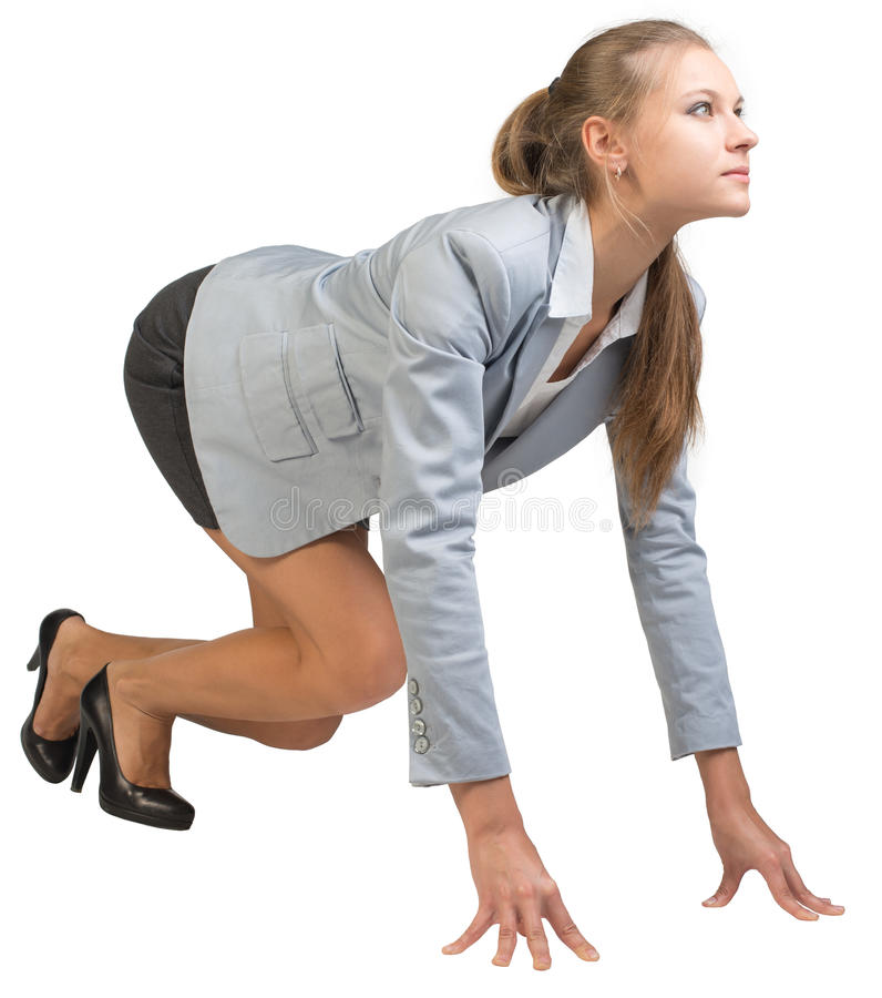 站立在良好的开端姿势的女实业家 库存图片