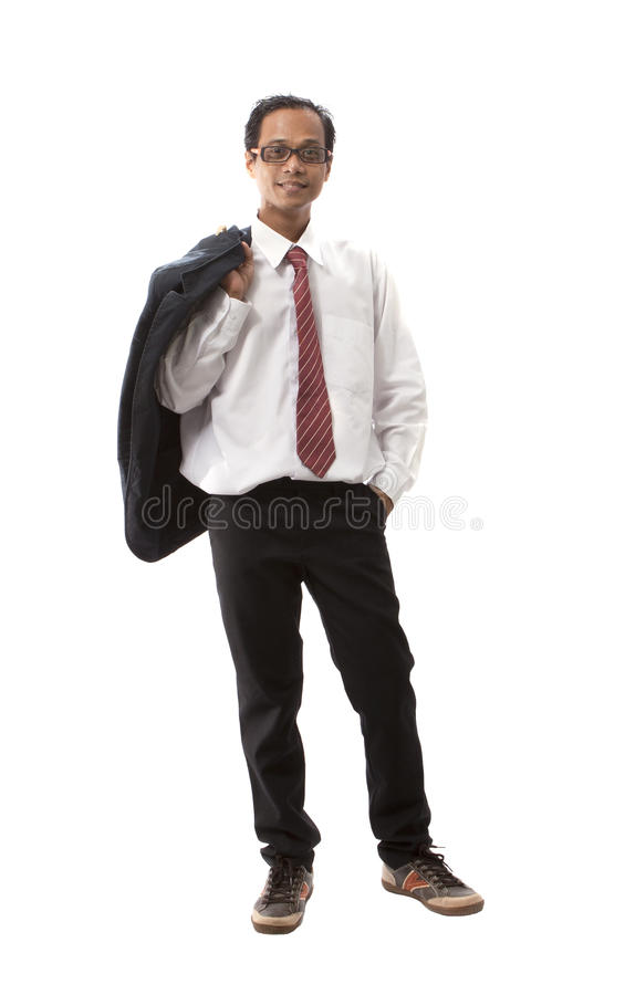 站立在西装的亚裔年轻人画象  免版税库存图片