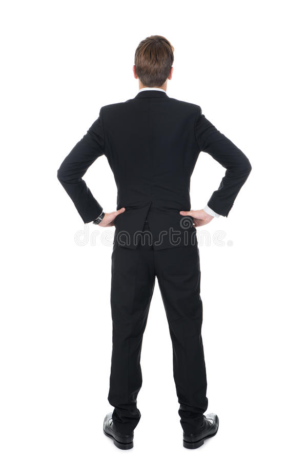 站立用在臀部的手的确信的商人 库存照片