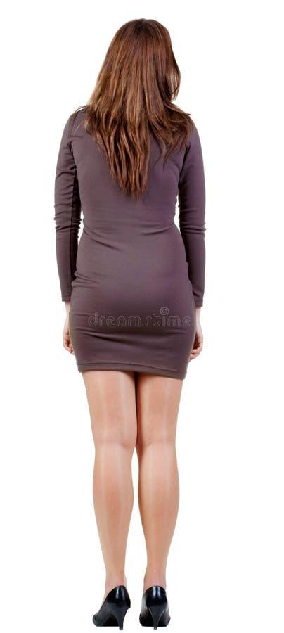 站立美丽的妇女后面看法 免版税图库摄影