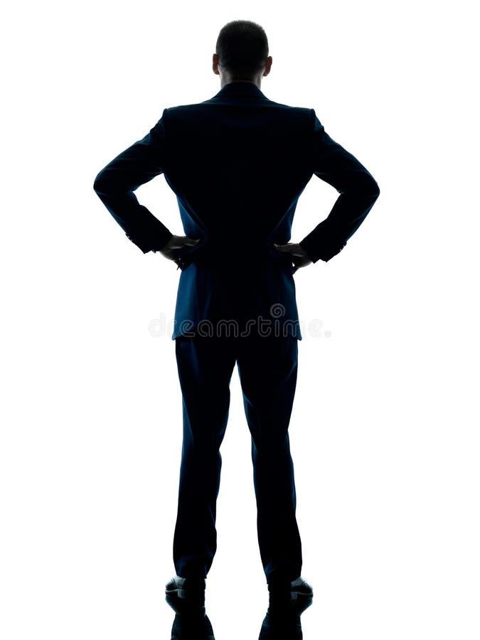 站立背面图的商人被隔绝 库存图片