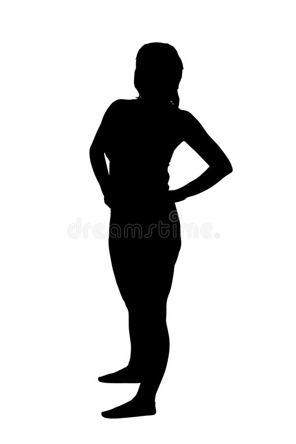 站起来妇女的剪影 免版税库存图片