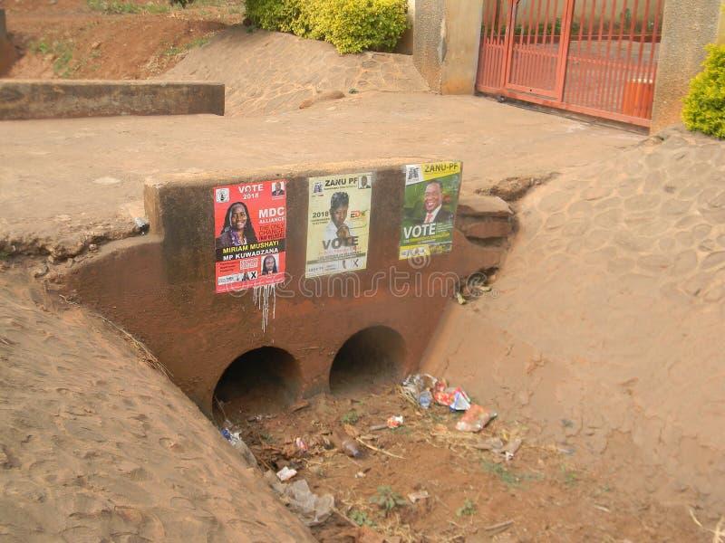 竞选活动海报在哈拉雷邻里 库存图片