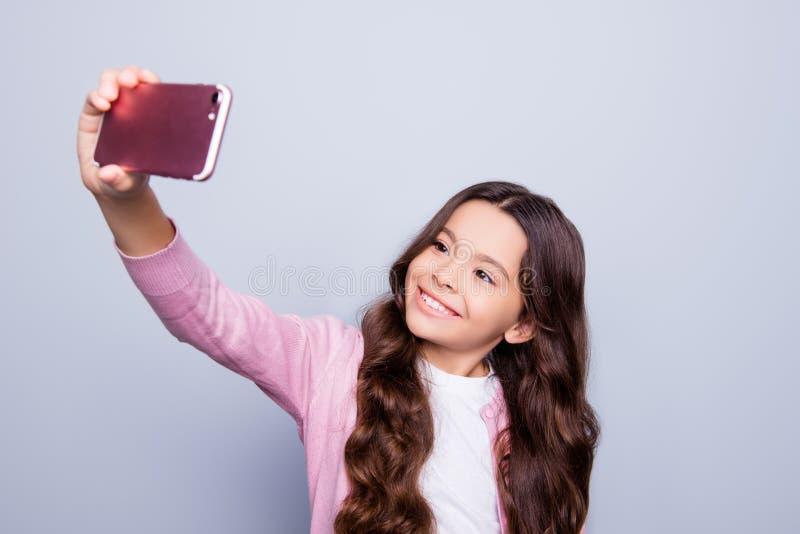 童年,对自已射击的瘾,电话,技术,相互 免版税库存图片