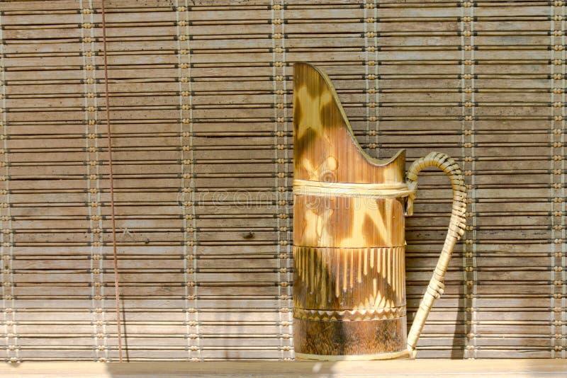 竹窗帘nd水罐 图库摄影