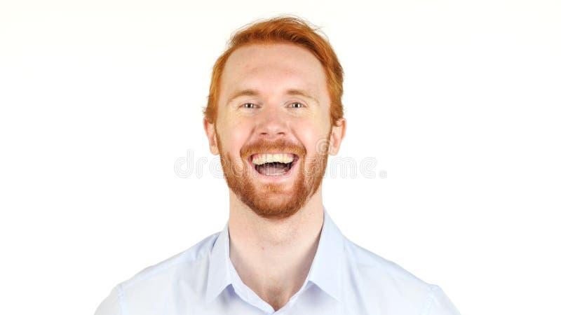 笑一个年轻红色头发的商人的画象,微笑 库存图片