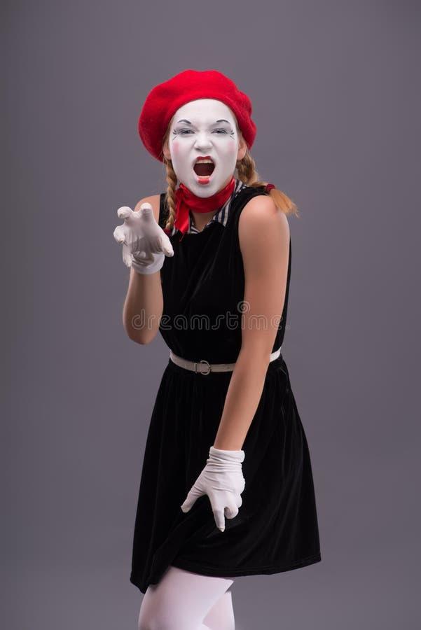 年轻笑剧女孩画象有白色面孔的 免版税库存照片
