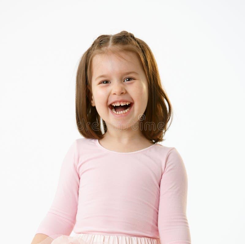 笑少许纵向的女孩 免版税库存图片