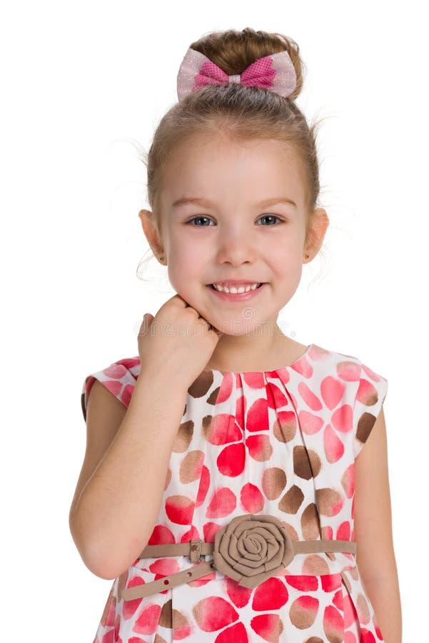 笑少许纵向的女孩 免版税库存照片