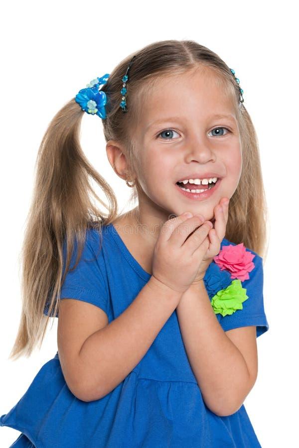 笑的小女孩 免版税库存照片