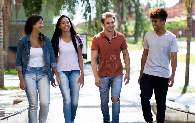 笑的小组多种族行家年轻成人在城市 免版税库存照片