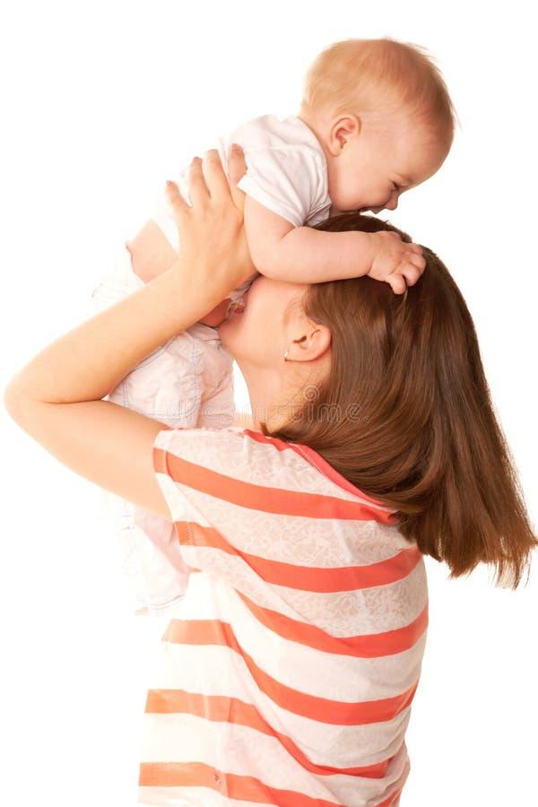 笑的母亲和的婴孩使用和。 库存照片