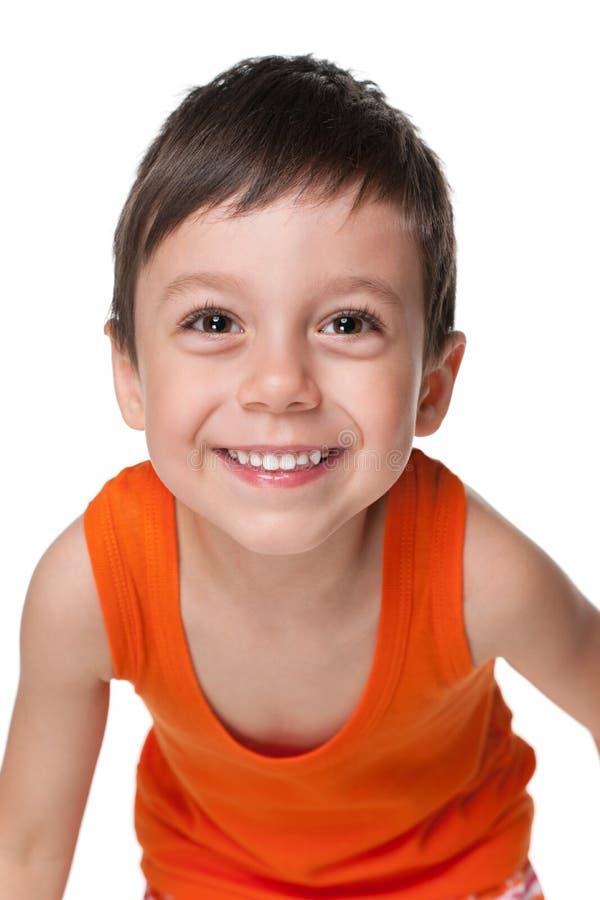 笑的逗人喜爱的小男孩 库存图片