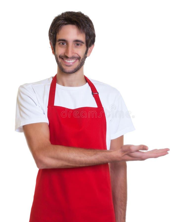 笑的酒吧老板提出某事 免版税库存图片