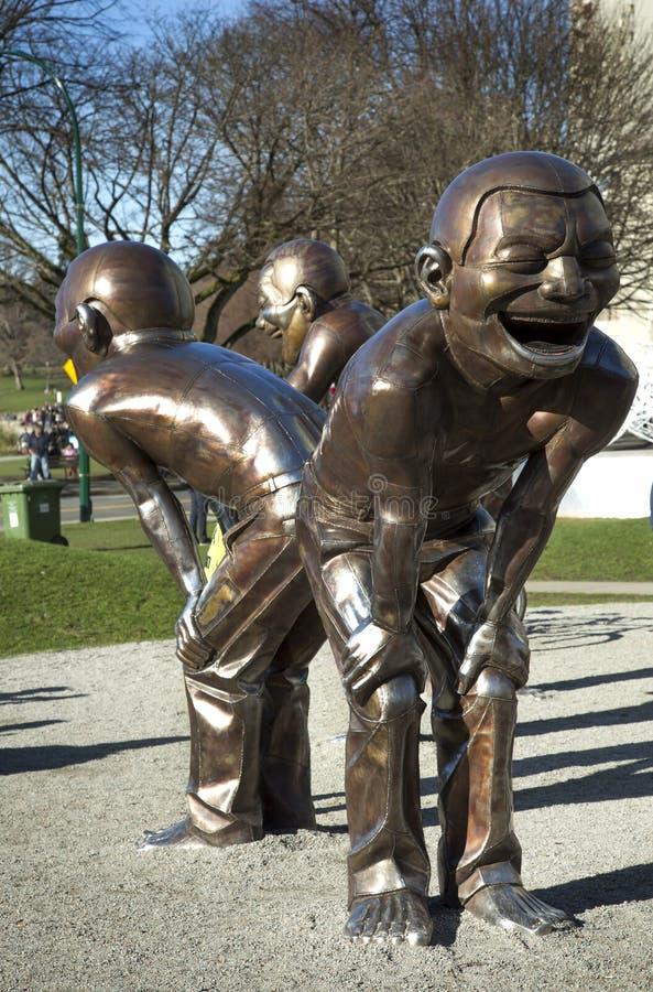 笑的雕塑在温哥华 库存照片