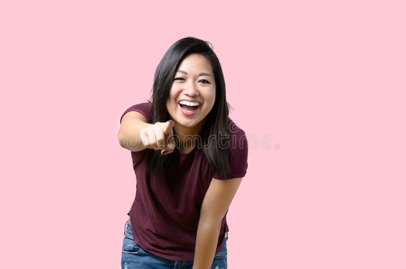 笑的活泼少妇指向 库存照片