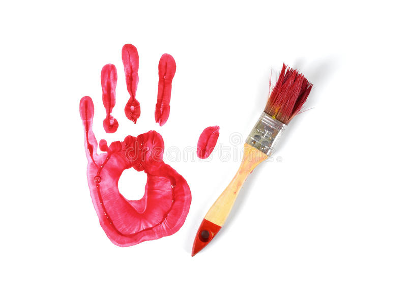 画笔和树胶水彩画颜料红色handprint在白色帆布背景在顶视图 库存照片