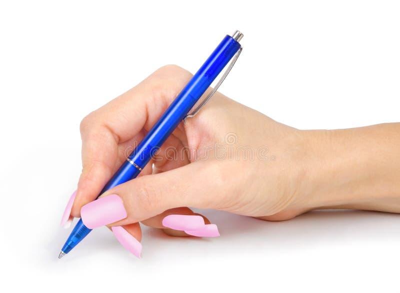 笔在白色的妇女手上 图库摄影