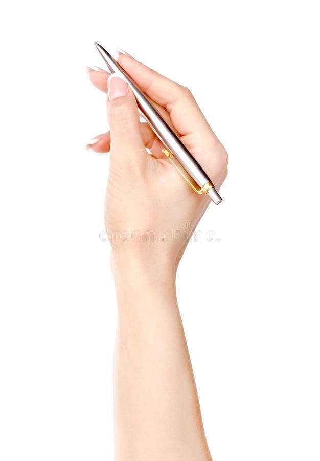 笔在白色隔绝的妇女手上 免版税库存图片