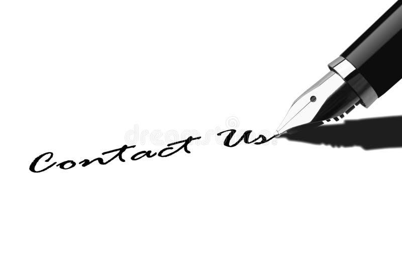 笔文字与我们联系 免版税图库摄影
