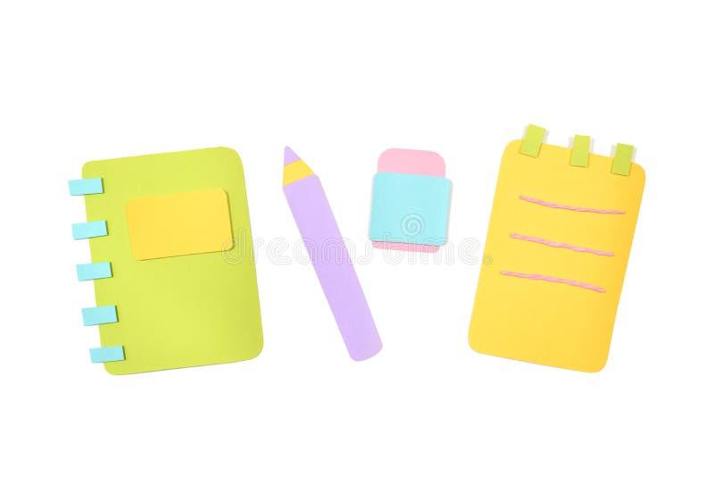 笔记本、铅笔和橡胶在白色背景 免版税库存照片