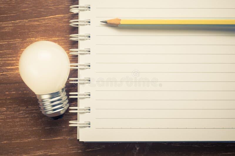 笔记本为启发文本 图库摄影