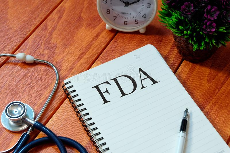 笔记本写与粮食与药物管理局& x28;美国食品药品监督管理局 库存照片