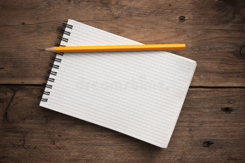 笔记本和铅笔 库存图片