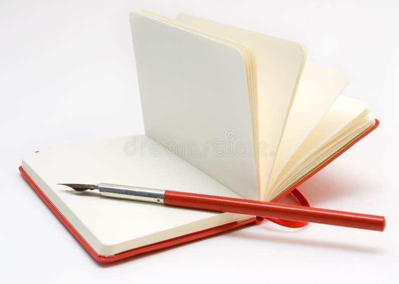 笔记本开放笔红色 库存照片