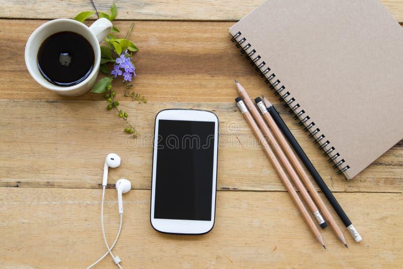 笔记本计划者,企业工作的手机 免版税库存照片