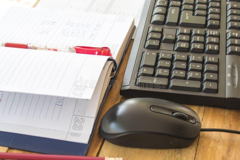 笔记本计划者,企业工作的财政决算 免版税图库摄影