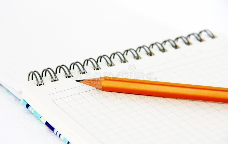 笔记本铅笔 图库摄影