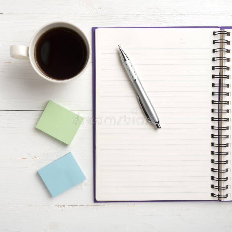 笔记薄和咖啡杯 免版税图库摄影