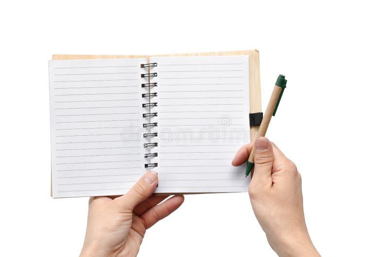 笔记薄在手上 免版税库存照片