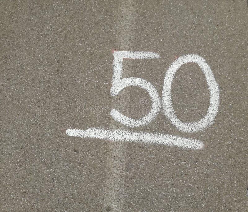 第50五十在灰色背景 免版税库存图片