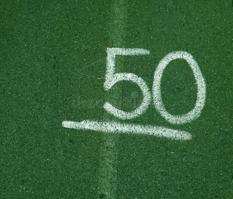第50五十在绿色背景 库存图片